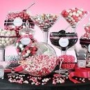 A Candy bar filled with treats in assorted glass jars, (Color of choice candy) party favor