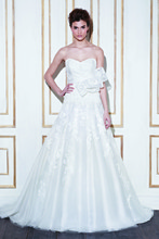 GALLOWAY Floor length A-line tulle gown with a lace covered sweetheart neckline bodice and lace floral appliqués on the tulle skirt; optional large lace bow can be added to highlight the waist