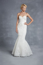 Blue by Enzoani Harrogate Scalloped hem lace combined with a chic sweetheart neckline and beaded lace bodice make this tulle mermaid gown the perfect vision of classic elegance. Covered buttons along the zipper provide the finishing touch.
