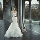 OFELIA A floor length dropped waist gown wit layers of tulle cascading down the skirt and a matching belt.