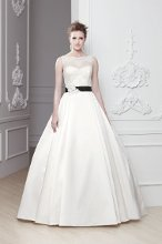 """Odina"" An A-line gown with an illusion neckline. Lace covered bodice and satin skirt with a black silk belt accented by hand beaded jewels."