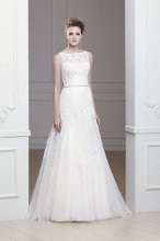 """Ola"" A modified A-line tulle gown with an illusion neckline. Lace appliques and jeweled belt."