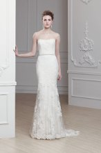 """Olva"" A modified A-line tulle gown with a sweetheart neckline, lace appliques, and hand jeweled belt."
