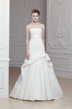 """Onawa"" A strapless modified A-line gown with dropped waist and gathering detail at the hip. Tulle bodice with lace applique. and pleated skirt."