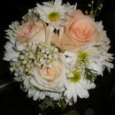 130x130 sq 1328753589576 weddingpeachandwhitebridesmaidsbouquets2