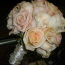 130x130 sq 1328753594281 weddingpeachandchampagnerosebridalbouquet