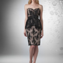 Sweetheart strapless lace neckline, short peplum skirt with Charmeuse band at waist with flower.
