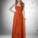 Sweetheart strapless shirred bust with ruffles, empire waist with ruffle wrap detail.