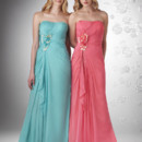 Strapless shirred fit body with two tone flower detail that gathers at waist.
