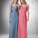 Shirred V-neck with spaghetti straps, criss cross shirred bodice with side drape skirt.