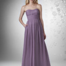 Slight sweetheart strapless neckline with shirred waistband, full skirt with pockets.