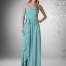 Slight sweetheart strapless neckline with shirred bodice with ruffle tie at waist.