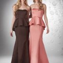 Strapless neckline, peplum with long straight skirt.