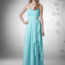 Strapless shirred sweetheart bust, empire waist w brooch, and side drape.