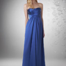 Strapless shirred bust and center front shirred waist. Grecian drape.