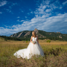 220x220 sq 1475166702414 chautauqua park wedding bride portrait in field on