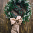 130x130 sq 1458845326943 wreath babies breath and greenery
