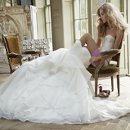 Coco Strapless bridal ball gown with swiss dot and lace corset bodice and full flounced skirt with petite band trim.