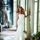 Reese Strapless slim lace bridal gown veiled in Silk Georgette with loose draped overlay and flower accented bodice.