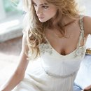 Nina Ivory Silk georgette Grecian draped bridal gown with crystal floral beaded straps and crisscross tulle detailing at center back with chapel train.
