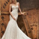 Style HP6404 2  Ivory over cashmere lace fit to flare bridal gown with lingerie strap detailing, english net ruched bodice and godets in skirt, bow at natural waist and chapel train.