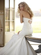 Gracie Strapless fit-to-flare Silk Organza embroidered bridal gown with scattered flowered motifs and sweetheart back.
