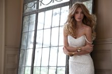 Vanna Ivory Sequin embellished lace fit-to-flare bridal gown with sweetheart neckline and plunging back with chapel train. Available in Ivory only.