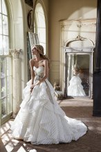 StyleHP6315 - Guindon Ivory striped organza strapless bridal ball gown with sweetheart neckline, full flounced skirt, and taupe raw silk sash at natural waist with chapel train