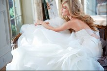 StyleHP6302 - Leighton Ivory strapless fit to flare bridal gown with silk stretch satin ruched bodice and sweetheart neckline with silk organza textured skirt, open back with tulle detailing connected by jeweled cluster at center and chapel train *Shown with crystal bolero