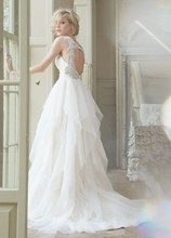 Carrie, Style 6350  <br /> Ivory english net A·line natural waist bridal gown with draped sweetheart bodice, tiered flounce skirt, crystal straps, keyhole back, and chapel train.