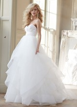 Londyn, Style HP6358  <br /> vory strapless natural waist bridal ball gown with silk radzmir crossover bodice, full tulle skirt with horsehair flounces and chapel train. Shown with matching horsehair veil.