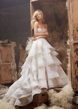 Style HP6400  <br /> Ivory over champagne english net geometric natural waist bridal ball gown with twist sweetheart bodice, horsehair tiered skirt and chapel train.