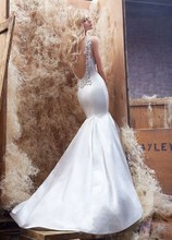 Style HP6402  <br /> Ivory silk satin trumpet bridal gown with V-neckline, beaded collar embellishment continuing to plunging back with chapel train.