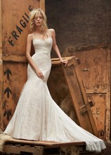 Style HP6404 2  <br /> Ivory over cashmere lace fit to flare bridal gown with lingerie strap detailing, english net ruched bodice and godets in skirt, bow at natural waist and chapel train.