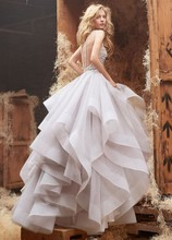 Style HP6413 2  <br /> Alabaster tulle bridal gown with halter high neck alabaster and crystal bodice, full horse hair flounced skirt and chapel train.