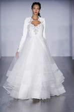 Style 6509/Dolly  Ivory hand cut faux leather ball gown, sculpted bodice with scalloped eyelet sweetheart neckline, tiered tulle skirt with horsehair trim.