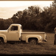 220x220 sq 1372522841860 bw couple with truck   rs
