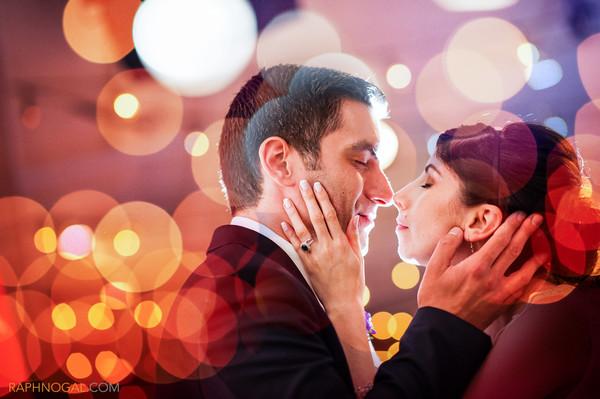 600x600 1432669378120 bride and groom red orange bokeh 1