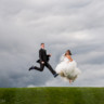 96x96 sq 1432669179433 bride and groom field jumping 2