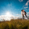 96x96 sq 1432669228702 bride and groom in field 1
