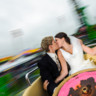 96x96 sq 1432669329321 bride and groom on tea cups at fair 1