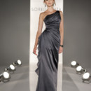 8191 Full length A-line gown in Satin. One-shoulder neckline with draped bodice, gathered waist with Chiffon frill accent.