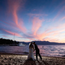 130x130 sq 1417657571395 zephyr wedding couple beach kiss sunset660