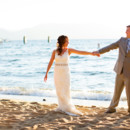 130x130 sq 1417657588225 zephyr wedding couple beach660