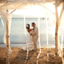 130x130 sq 1417657616474 zephyr wedding couple beach birch660