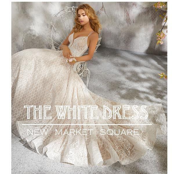 The white dress dress attire wichita ks weddingwire for Wedding dresses wichita ks