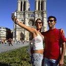 130x130 sq 1335556155107 touristcouple