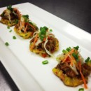 130x130 sq 1445443774652 pulled pork  slaw topped corn cakes