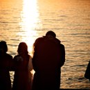Jessica and Chris' sunset silhouetted wedding kiss!