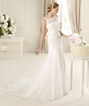 GALES The Gales model from the Manuel Mota 2013 collection for Pronovias is a beautiful choice. Fashioned in soft chiffon, the boat-necked bodice has a net overlay featuring strips of fabric revealing a lovely bodice beneath. The waist is emphasised by a belt which marks the top of the perfect flared skirt.